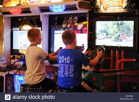 Boys Playing Shooting Games At A Video Arcade In Midtown