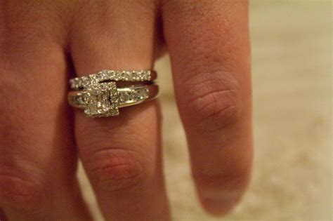 does the wedding band or engagement ring go on first 6