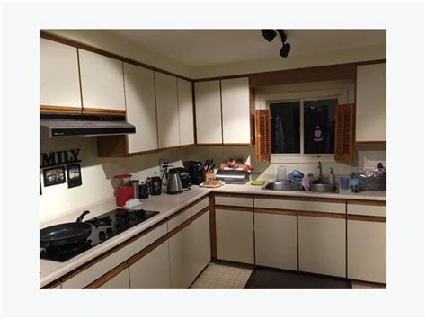 White Melamine Kitchen Cabinets Outside Comox Valley