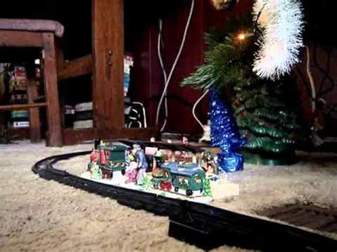 toy train going around top of a tree our tree and moonbo going around it