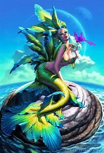 Beautiful Female Mermaids Swimming