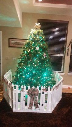 christmas tree fence for dogs toddler proofing the tree cheap picket fence from lowe s could also add some glitter and snow