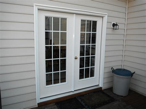 before and after of new therma tru smoothstar fiberglass