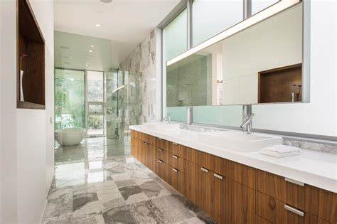 zebra wood cabinets  white countertops  gray