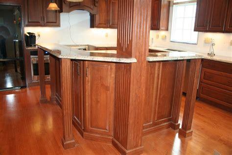 Dark Hardwood Floors: Oak Cabinets And Dark Hardwood Floors