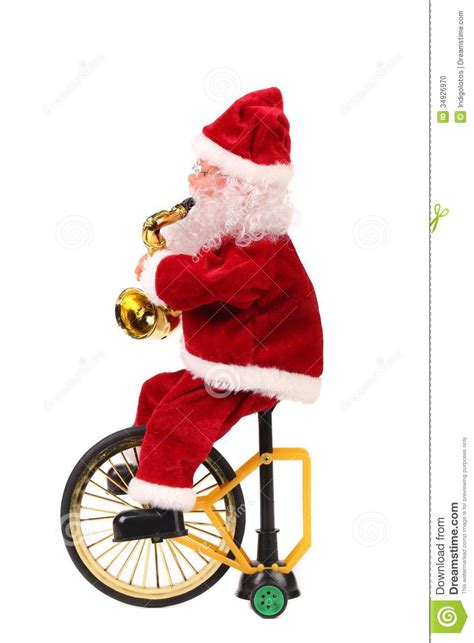 santa claus doll on a bike stock photo image 34926970