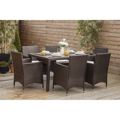 7 piece dining table with 6 cube chairs in brown rattan garden dining sets