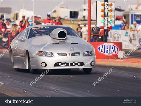 A Pro Stock Race Car Leaving The Start Line Stock Photo