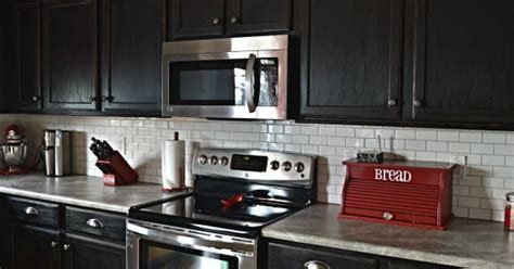 black tile kitchen backsplash white subway tile backsplash with black cabinets hometalk 4751