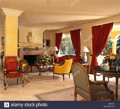 Red Curtains And Colourful Chairs And Sofa In Spanish