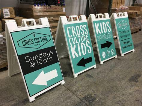 cross culture church denver uses sidewalk signs for