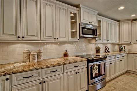 white cabinets with Antique Mascarello counter top