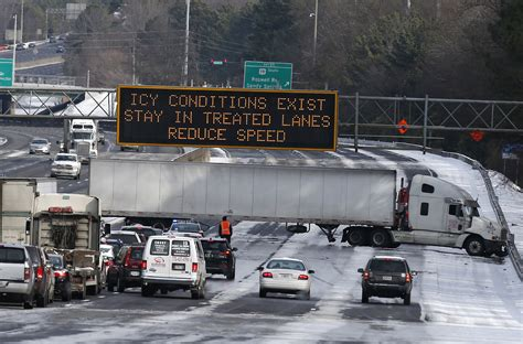 Cleanup Begins After Epic Snow Traffic Jam In Atlanta
