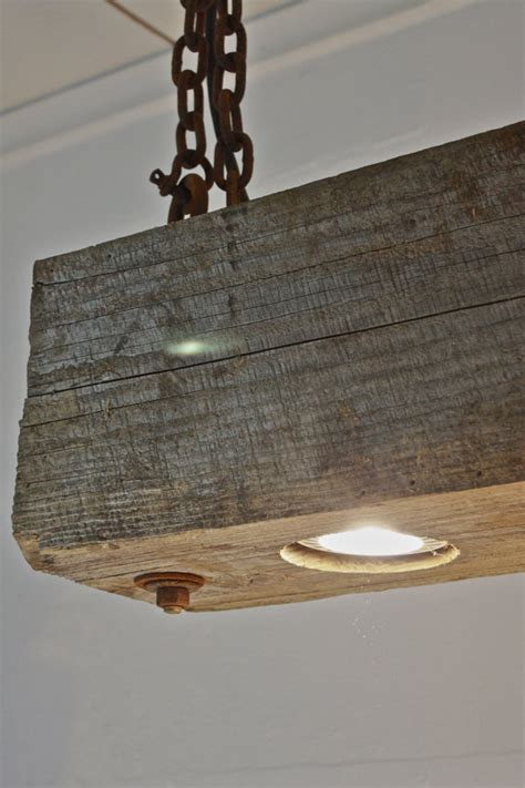 rustic modern hanging reclaimed wood beam light by