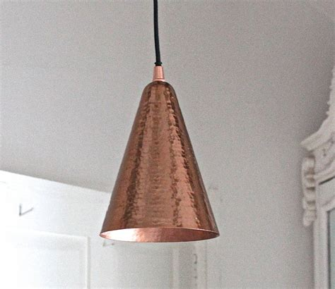 hammered copper pendant light by the forest co