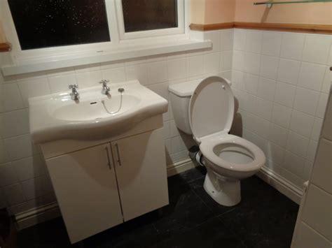 curved shower  modern storage sink unit  cream tiles