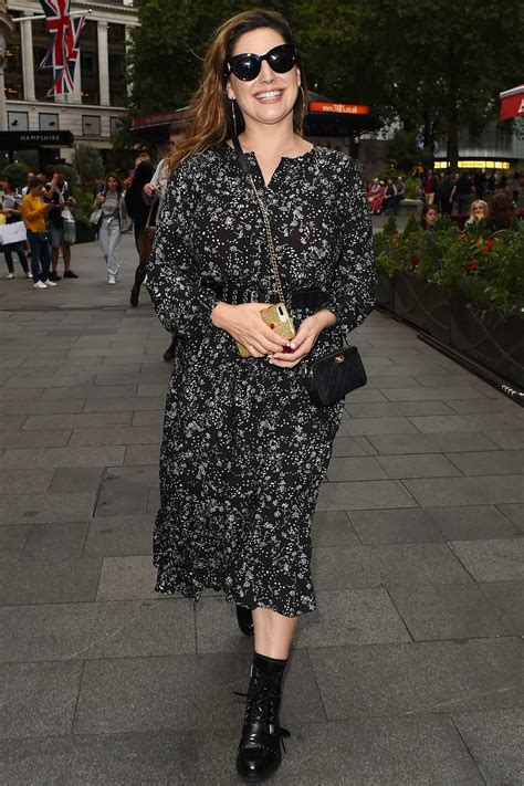 kelly brook dons a monochrome floral dress as she arrives ...
