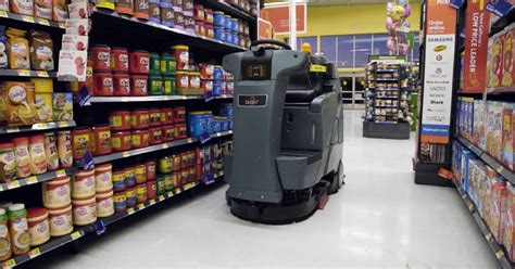 walmart   hundreds  ai robot janitors  scrub