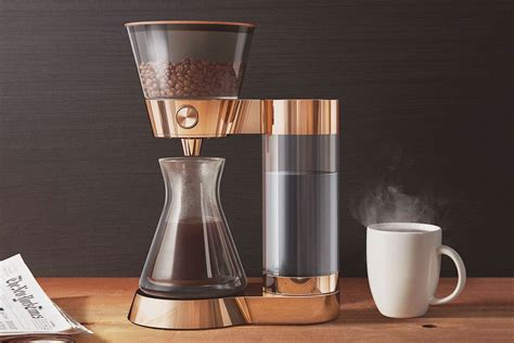 The borosilicate glass coffee maker features a stainless steel fine mesh filter. Poppy Pour-Over Smart Artisanal Coffee Machine | LifeStyle Fancy
