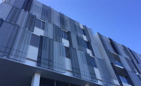 building facade perforated metal arrow metal arrow metal