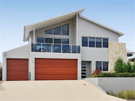 facade of the house concrete modern house exterior with balcony landscaped garden house facade photo 104491