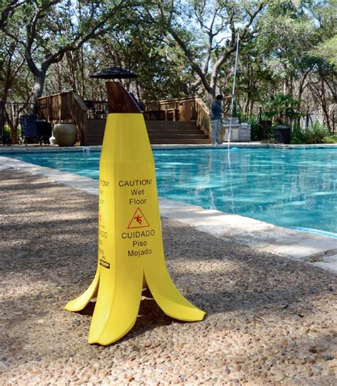 caution floor banana sign a and creative floor sign that is shaped like a