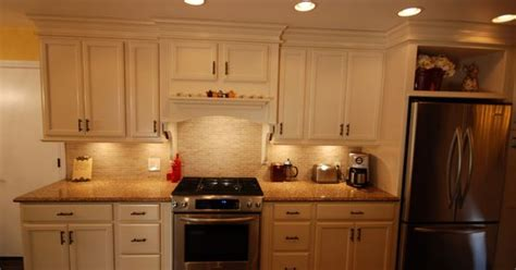 soft white kitchen cabinets kraftmaid bisque glaze cabinets with cambria brownhill 5591
