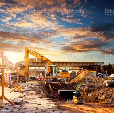 The number of people who keep sharing the weirdest of pictures on instagram has. Excavator On A Road Construction Site Stock Photo ...
