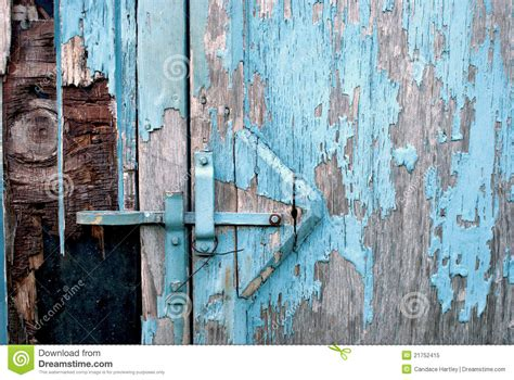 closeup   rustic shed  blue peeling paint royalty  stock photo image