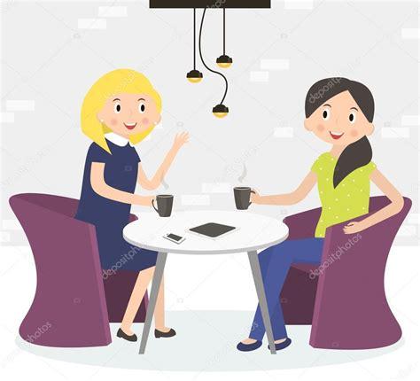 Dos amigas lindas bebiendo café Mujer sentada en un café