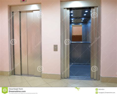 modern elevator  opened  closed doors stock images