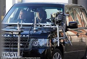 Daniel Craig gets to grips with a Range Rover while ...