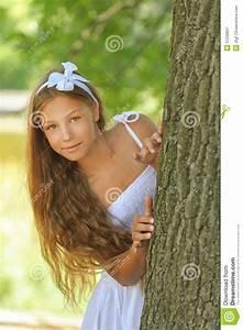 Frightened Teenage Peeping From Behind Tree Stock Image ...