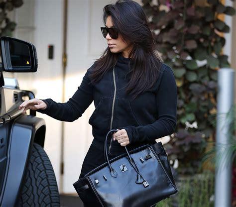 kim kardashian  loves  hermes  black birkin purseblog