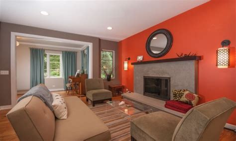 turquoise curtains and red couches in living room peach