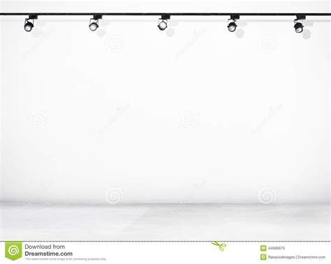 White Wall And Concrete Floor With Spotlights Stock Photo
