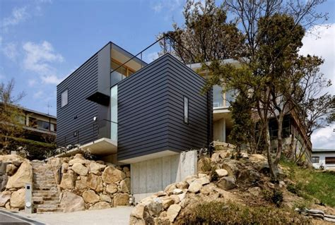 Steep Slope House With Bookshelflined Interior Modern