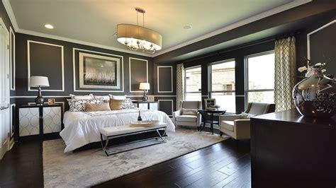 deco master bedroom with crown molding chandelier in
