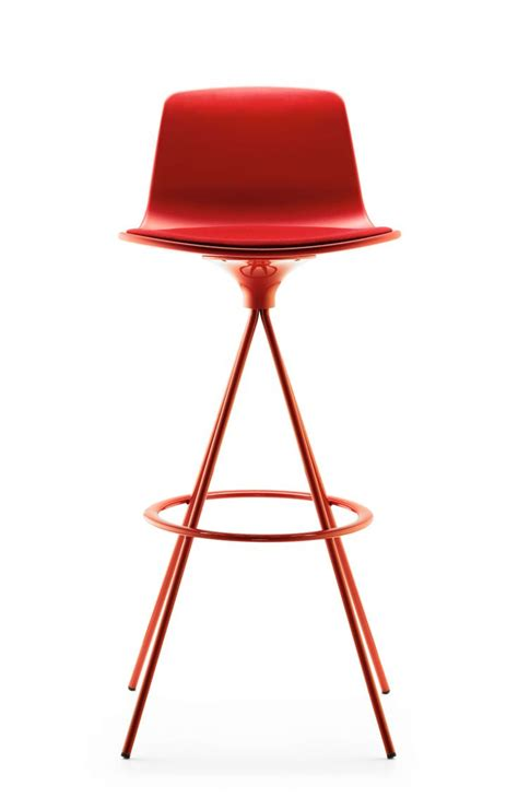 the lottus stool follows the aesthetics of the chair and