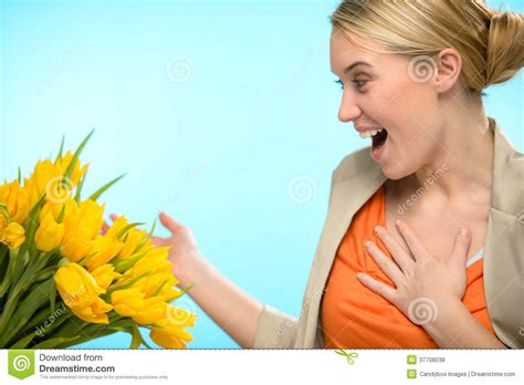 Surprised Woman Receive Bouquet Of Yellow Tulips Stock