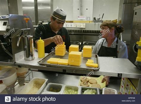 fast food kitchen design two employees work in a kitchen at a mcdonalds restaurant 7173