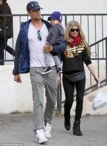 Fergie and Josh Duhamel take turns cradling their adorable ...