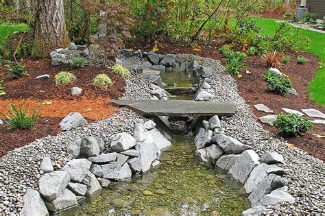 landscaping ideas for water runoff dry creek bed for storm water runoff outside pinterest