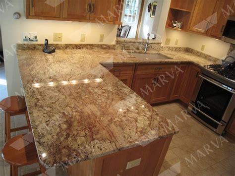 typhoon bordeaux granite countertops with beige tile