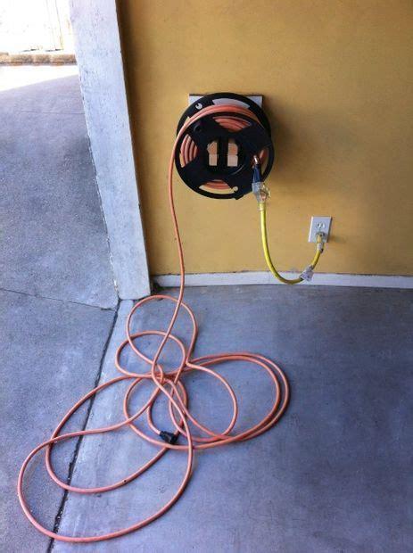 homemade extension cord winder mount garage organization