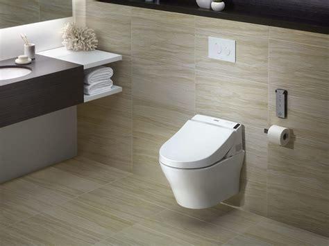 Wallmount Dualflush Toilet  Kitchen Bath Design. Hanna Plumbing. Coastal Home. Caeserstone. Marble Bathrooms. Barnwood Cabinets. Double Crown Molding. Two Tone Bathroom. Contemporary Ceiling Fan