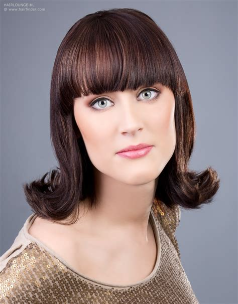 Flip Hairstyles by 60s Flip Hairstyle With An Outward Roll Of The Hair