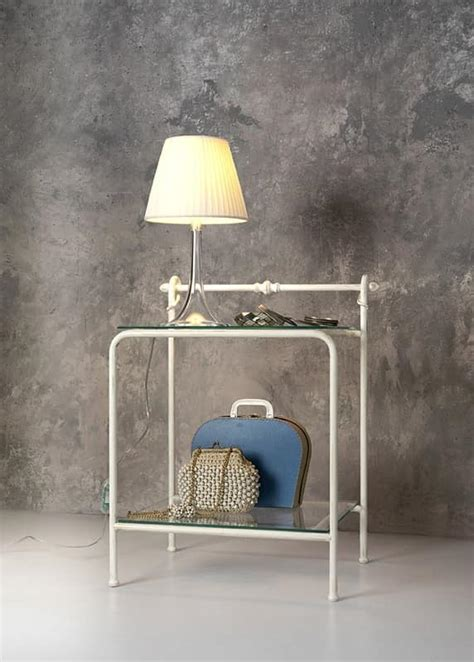 classic bedside table  metal  glass  hotel room