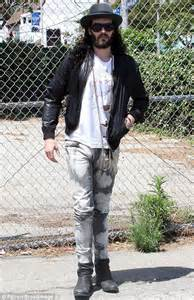 russell brand jeans russell brand has a style emergency in a ripped t shirt