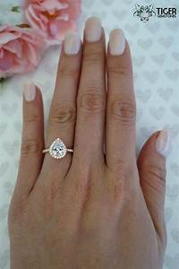 Order of wedding and engagement rings on finger for Wedding band engagement ring order